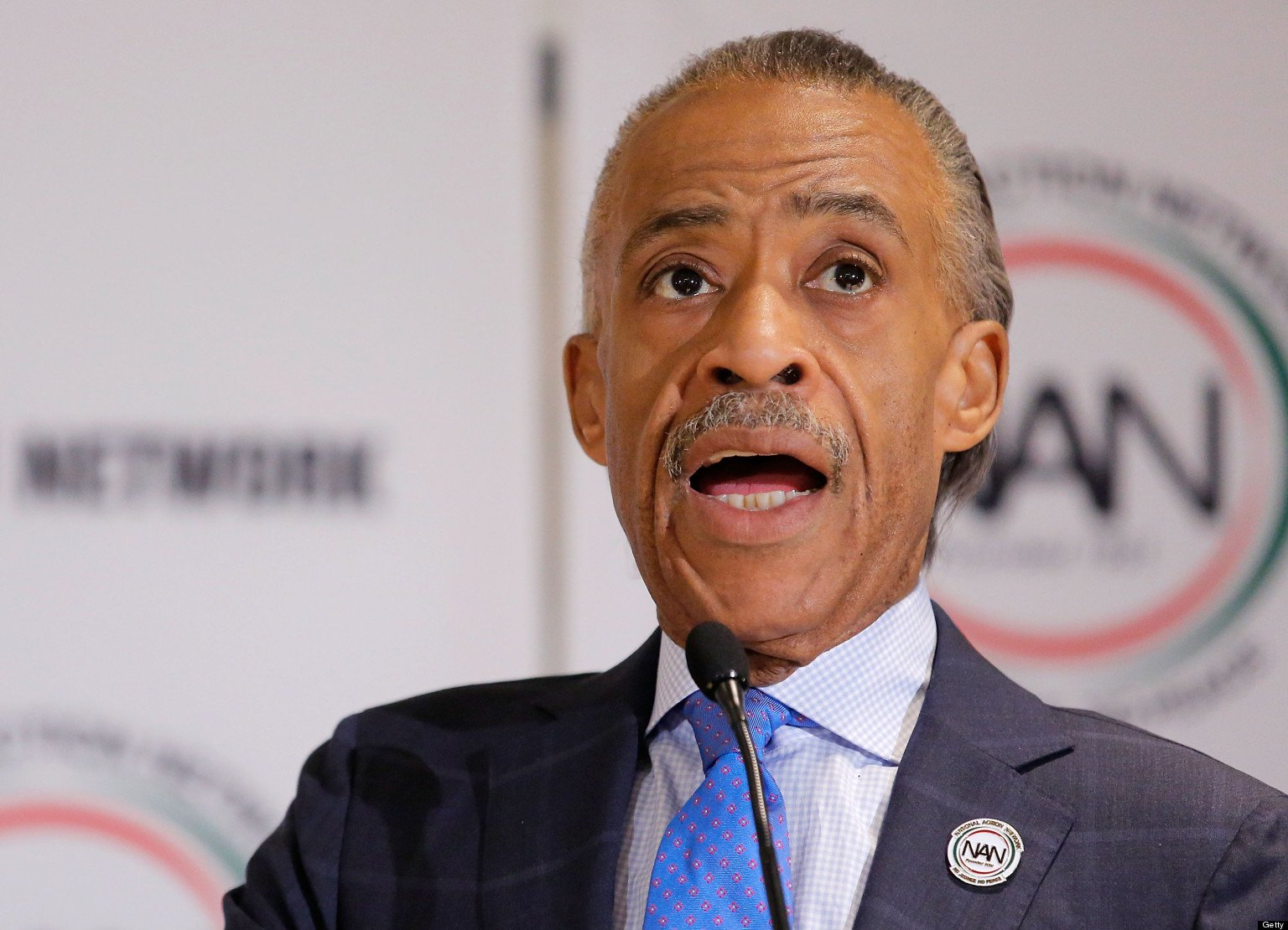 Al Sharptons halfbrother charged with murder  day after leading antigun protest