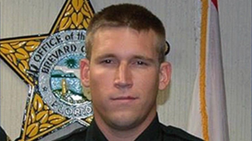 Floridas 2016 Officer of the Year arrested after feces guns drugs allegedly found in his disgusting home