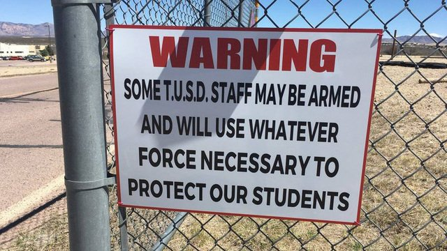 Arizona School posts warning sign that staff is armed