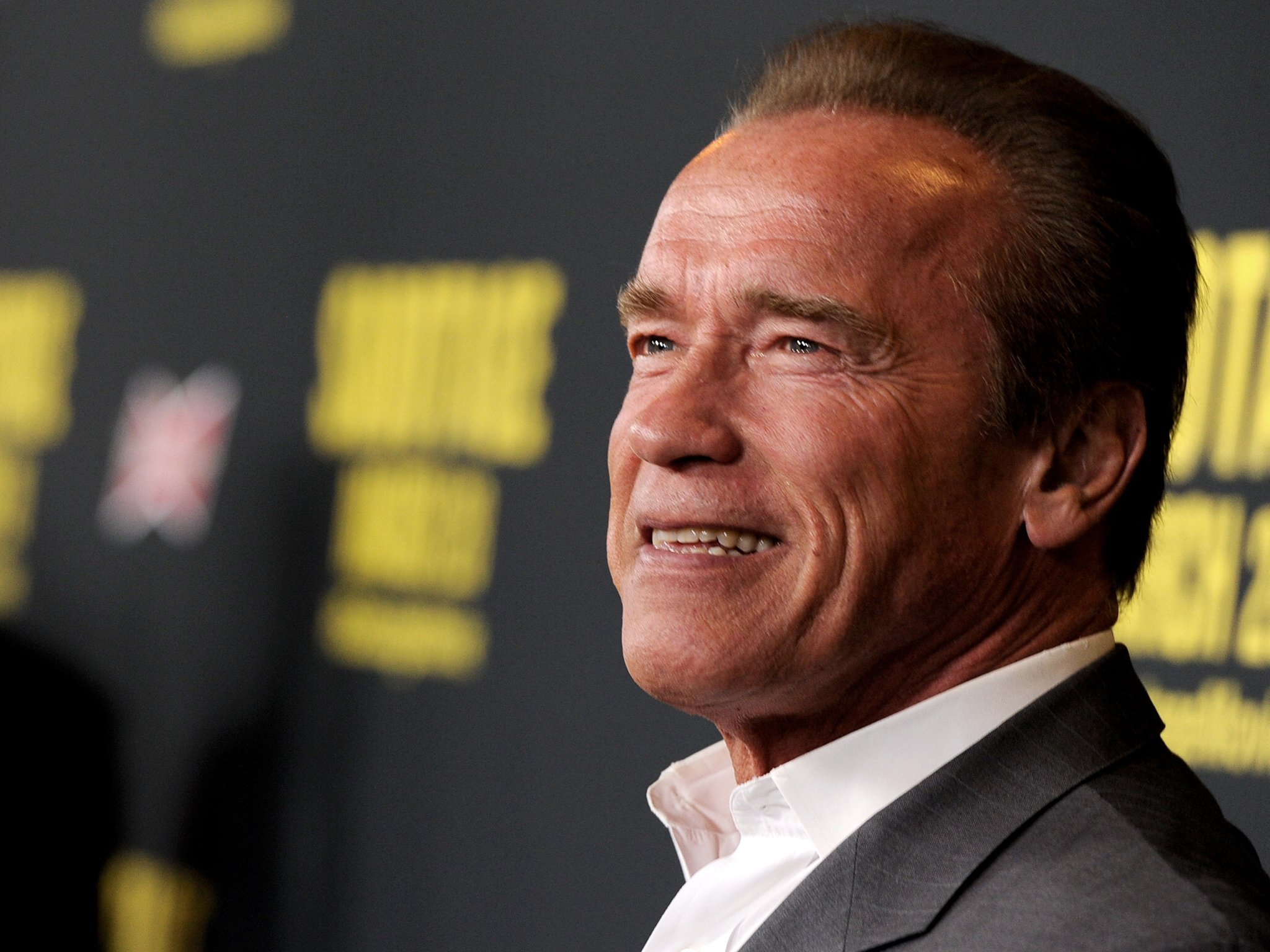 Conservative Street Artist Takes Aim At Arnold Schwarzenegger With MeToo Posters
